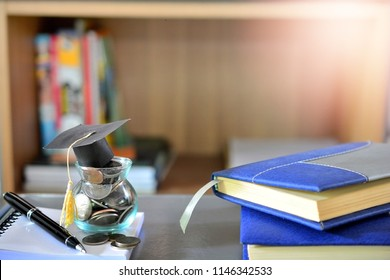 hat graduation model on money coins  for concept investment fund finance and education scholarships