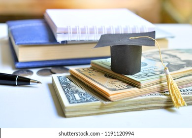 hat graduation model set on money banknote for investment education finance and scholarships