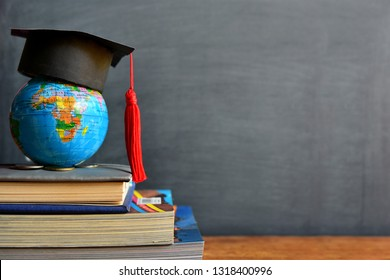 hat graduation on globe model for concept education and scholarships