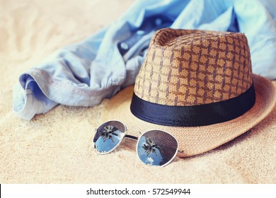 hat and sunglasses on the beach