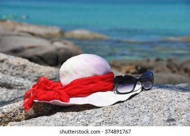 Hat and sunglasses on the rock. Phuket island, Thailand