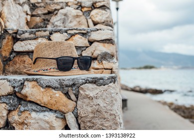 Hat with sunglasses on the stairs