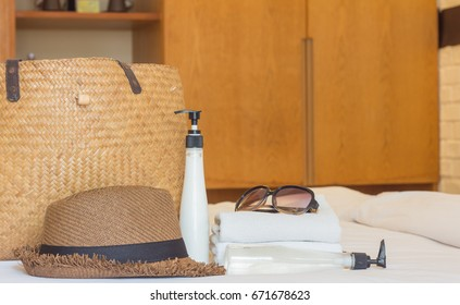 hat travel and basket  on the bed
