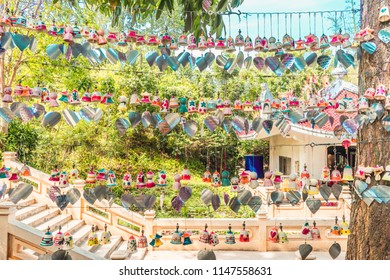 Hat Yai, Thailand – 1 May 2018: Many bells with wishes is located on top of a hill at Hat Yai Municipal Park.
