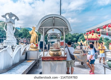 Hat Yai, Thailand – 1 May 2018: The 20 metres high white jade statue of Kuan Yin, Goddess of Compassion & Mercy is located on top of a hill at Hat Yai Municipal Park.