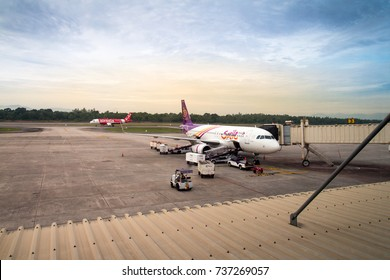 HAT YAI, THAILAND- AUG 29, 2017: Thai Smile airline parking at the terminal during sunrise at Hat Yai International Airport in Songkhla Province, Thailand