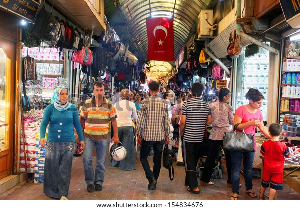 HATAY, TURKEY - AUGUST 21: People walking and shopping in historical place 'Uzun Carsi' on August 21, 2011 in Hatay, Turkey. Uzun Carsi is oldest and one of the most important shopping certer in Hatay