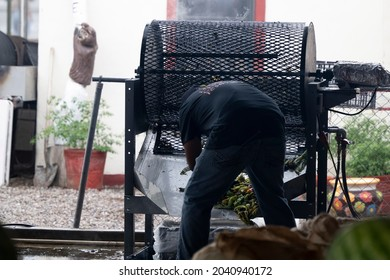 HATCH, NEW MEXICO - SEPTEMBER 4, 2021: A worker roasting green chiles during the annual Hatch Chile Festival.