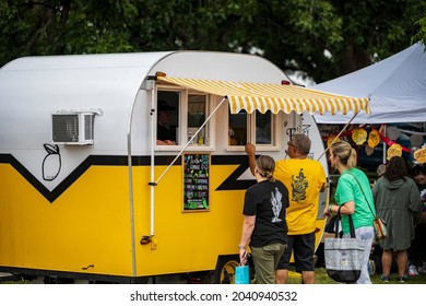 HATCH, NEW MEXICO - SEPTEMBER 4, 2021: Famiy purchsaing lemonade during the annual Hatch Chile Festival.