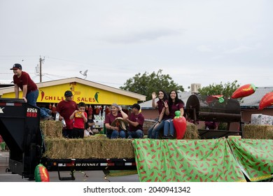 HATCH, NEW MEXICO - SEPTEMBER 4, 2021: People on a flatbed float in the parade during the annual Hatch Chile Festival.