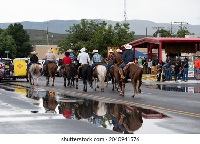 HATCH, NEW MEXICO - SEPTEMBER 4, 2021: Local farm and ranch workers riding horses in the parade during the annual Hatch Chile Festival.