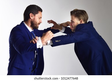 Hate, aggression concept. Conflict of interest, political fight, business. Men wearing formal suits and boxing. Manager and director fighting. Brutal, angry politicians. Democrats and republicans.