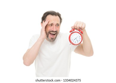 Hate being late. Man hold alarm clock in hand. Guy bearded mature man worry about time left. Time management and discipline. Punctuality and responsibility. Man with clock on white background.