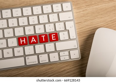 Hate key on a computer keyboard. Defamation on line concept.