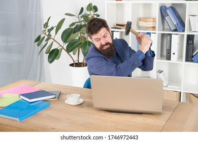 hate my job. dealing with error. overworked man crush laptop with hammer. frustrated computer user. businessman express anger. ready to smash. Office life makes him crazy. Slow internet connection.