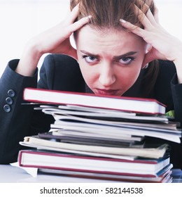 I hate my office work.  Businesswoman in problems. Alone working in office with a lot of documents. Yelling and screaming for bad results. (psychological portrait, aggression, anger, frustration)