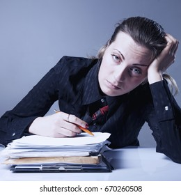 I hate my office work. Young businesswoman working with documents. Low wages, overtime working hours, lack of career prospects concept. (Body language, gestures, psychology)