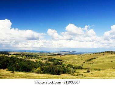 Hateg,Romania.Rural landcsape against blue cloudy sky.