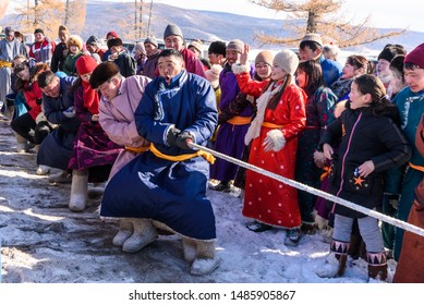 Hatgal, Mongolia, Febrary 25, 2018: Mongolian people compete in the tug-of-war in the winter games outdoor