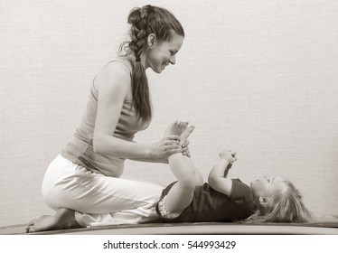 Hatha yoga fitness mother with baby