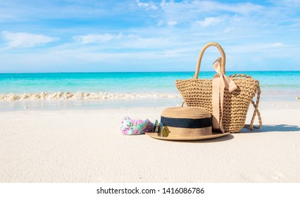 Hats and glasses placed on the beach and sea have a holiday summer relaxing and travel bright sky koh lipe thailand