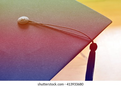 Hats graduates place book on wood background