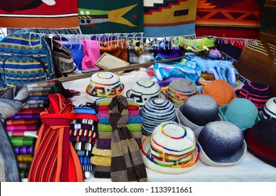 Hats and other hand crafted goods on a stall in the street market in Otavalo, Ecuador