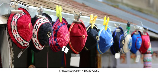 hats typical of Jews embroidered with wool for sale at a stall called kippahs
