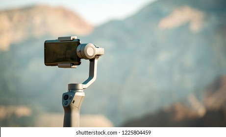 HATTA, DUBAI, UAE - OCT 19, 2018: Using the DJI Osmo Mobile 2 stabilizer within the mountains of Hatta during autumn