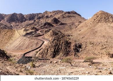 Hatta Wadi Hub mountain carting downhill trail with car tires fence, Hajar Mountains, United Arab Emirates.