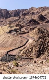 Hatta Wadi Hub mountain carting downhill trail with car tires barrier, Hajar Mountains, United Arab Emirates.