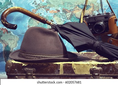 Hat,umbrella,camera,card,suitcase. Background travel.Photo toned in retro style.