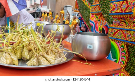 Hatyai, Songkhla, Thailand - Oct. 25, 2018 : Make merit and give food offerings to Buddhist monks or Donate money on The End of Buddhist Lent Day in Chak Phra Festival (Pulling the Buddha ) at Hatyai