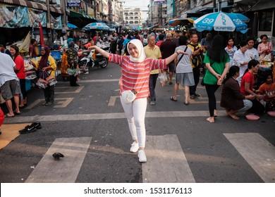 Hatyai, Thailand - Circa October,2019 : Asian woman muslim travellers show us this Kim Yong fresh market,Song Khal street.