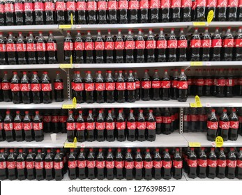 HATYAI, THAILAND - DEC, 2018: a classic Coca Cola editorial photo of carbonated soft drinks, as a giant market player, on a shelf of modern trading products. Thai version of Coca Cola.