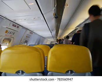 Hatyai, Thailand - December 6th, 2017: Image of interior, yellow seats and passengers in economy flight Nok air airline arrival at Hatyai airport, Thailand.