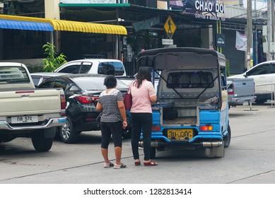 Hatyai Thailand DECEMBER 8, 2018.Passenger taking  Tut tut on the road of Hatyai, economical public transportation in Thailand - Image