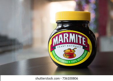 HATYAI, THAILAND - JAN 1, 2016: Marmite jar of yeast extract spread for bread or toast on the table