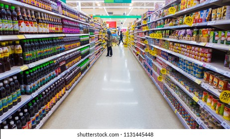 Hatyai, Thailand - JULY 09, 2018:  Aisle view shelf products and people shop at Tesco Lotus supermarket. Tesco Lotus is the world's second largest retailer