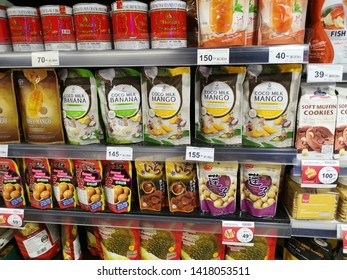 Hatyai, Thailand, June 2,2019 : Variety of junk fruits flavored in packages are displayed on shelves for sale at Robinson Shopping Mall.