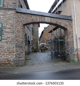 Hatzenport, Rheinland-Palz / Germany - January 6 2018: Romantic get away town stone court with wagon and gate along the Mosel (Moselle) River in Rheinland-Pfalz, Germany.