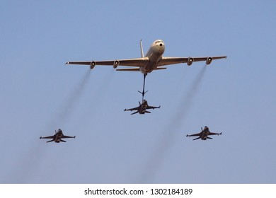 Hatzerim, Israel 06 28 2018: Israeli Air Force F-16 jets flying in close formation with a tanker aircraft during an airshow at Hatzerim, close to Beersheva Israel
