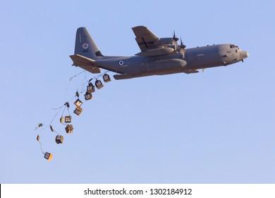 Hatzerim, Israel 06 28 2018: Israeli Air Force C-130 Hercules dropping cargo during an airshow at Hatzerim, close to Beersheva Israel