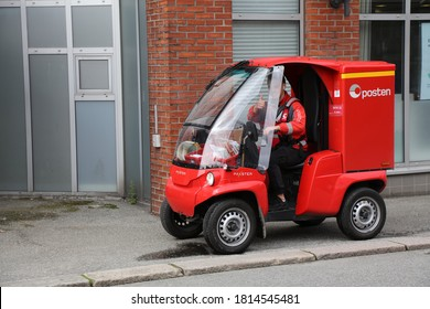HAUGESUND, NORWAY - JULY 22, 2020: Mailman works his route in an electric zero emission Paxster vehicle in Haugesund. Posten Norge  is The Norwegian Post service.