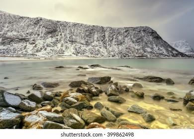 Haukland Beach in the Lofoten Islands, Norway in the winter at dusk.