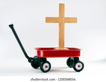 Hauling the old wooden cross in a little red wagon.