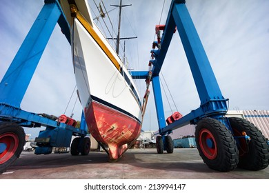 hauling out a sailing boat in boatyard