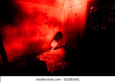 Haunted Doll,Ghost in Haunted House,Mysterious Woman in White Dress Sitting in Abandon Building,Horror Background For Halloween Concept and Book Cover Ideas