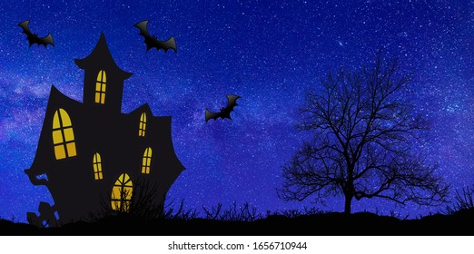 Haunted House and lone tree silhouetted againist the evening sunset on Halloween night