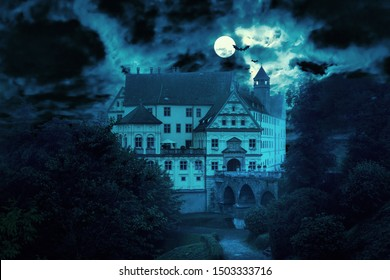 Haunted house at night. Old spooky castle in full moon. Creepy view of dark mystery mansion with bats. Scary gloomy scene for Halloween theme. Horror and terror concept.